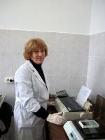 Научный сотрудник И.А.Гварамия за работой на иммуноферментном  анализаторе УНИПЛАН тм